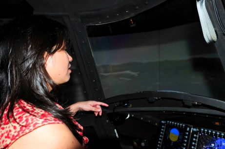 Kristen Yamane, a Corporate Development Planner with the Queen's Health Systems, scans the area ahead of her as she flies in the CH-47 Chinook simulator during a visit to the 25th Combat Aviation Brigade, 25th Infantry Division to learn about the Army's risk management process for its pilots on Wheeler Army Airfield, Hawaii, June 12.