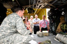Staff Sergeant Lee Hockersmith, a flight medic assigned to Company C, 3rd Battalion, 25th Aviation Regiment, 25th Combat Aviation Brigade, briefs medical officials from Queens Medical Center about the medical procedures in a UH-60 MEDEVAC Black Hawk during a visit to the 25th CAB, 25th Infantry Division on Wheeler Army Airfield, Hawaii, June 12.
