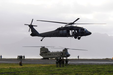 Navy divers with the U.S. Navy SEAL Delivery Vehicle Team 1, Naval Special Warfare Group 3 secure themselves to the Special Patrol Insertion and Extraction rope during SPIE training with flight crews from the 25th Combat Aviation Brigade at Marine Corps Air Station Kaneohe Bay June 18.