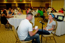 Staff Sergeant Brandy Gately, a spectrum manager assigned to Headquarters and Headquarters Company, 25th Combat Aviation Brigade, listens as her husband Staff Sgt. Adam Gately, a spectrum manager with the 45th Sustainment Brigade, role plays a scenario during the communication techniques class while attending the 25th CAB Strong Bonds Marriage Retreat at the Hale Koa Hotel in Honolulu June 27.