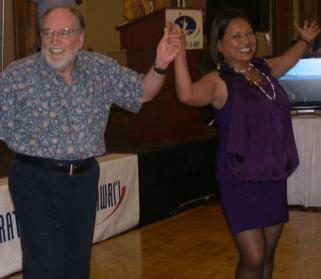 Gov. Neil Abercrombie dances with House Majority Floor Leader Rida Cabanilla (courtesy Facebook)