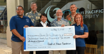 (L-R) Sahen Aguina-Uruchurtu, HPU student body VP; James C. Polk, SVP, Bank of Hawaii; Donna Tanoue, president, Bank of Hawaii Foundation; Geoffrey Bannister, president, HPU; Michael J. Chun, chairman, HPU Board of Trustees; and Miina Huotari, HPU student body president.