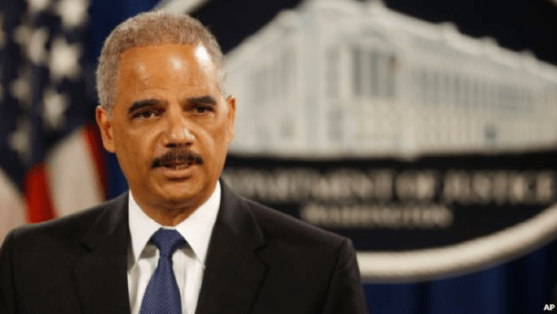 Attorney General Eric Holder speaks at a news conference at the Justice Department in Washington, May 19, 2014.