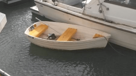 The Coast Guard is requesting assistance in locating the owner of a white, eight-foot dinghy found at 4 p.m., July 9, in Maunalua Bay, east of Diamond Head. (U.S. Coast Guard courtesy photo)