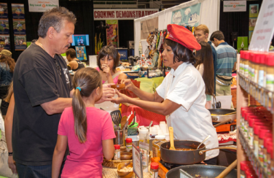 Kai Cowell, owner of Kaiulani Spices, cooks up samples for festival-goers