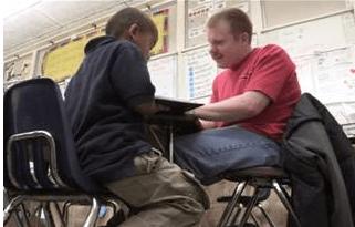 Jeff Balek with a student