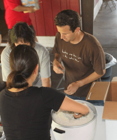 U.S. Senator Brian Schatz serves food to Hawaii island residents impacted by storm (Photo by Damon Tucker)