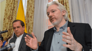 "Ecuador's Foreign Minister Ricardo Patino (L) and WikiLeaks founder Julian Assange speak during a press conference inside the Ecuadorian Embassy in London, where he confirmed he ""will be leaving the embassy soon"", Monday Aug. 18, 2014."