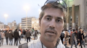 FILE - This undated image, from video released by GlobalPost April 7, 2011, shows freelance journalist James Foley in Benghazi, Libya.
