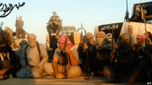 FILE - This scene from a propaganda video released June 8, 2014, allegedly shows militant group Islamic State fighters gathered near Tikrit, Iraq.