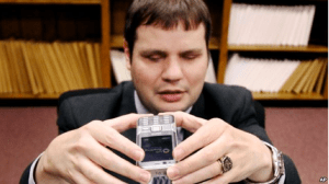 Chris Danielsen, a spokesman for the National Federation of the Blind, takes a photo of a document with a cell phone while demonstrating how the text on the document will be converted into speech in this Jan. 24, 2008 file photo.