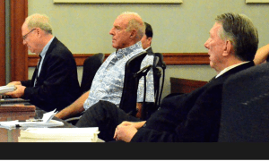 James Pflueger with his attorneys in court Oct. 15, 2014