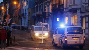 Belgian police officers guard a street in Verviers, Belgium, Friday, Jan. 16, 2015.