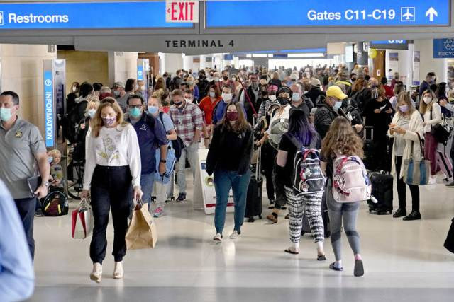 Fully vaccinated people can travel safely again, CDC says