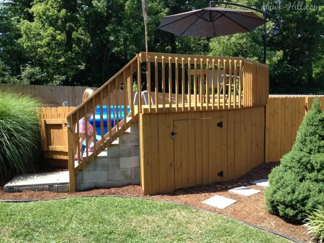 Wooden deck around above ground pool