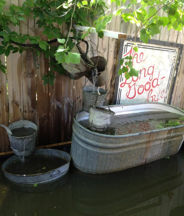 2012 pond fountain arrangement. The 100 gallon galvanized trough is set on bricks and creates a large overflow waterfall.