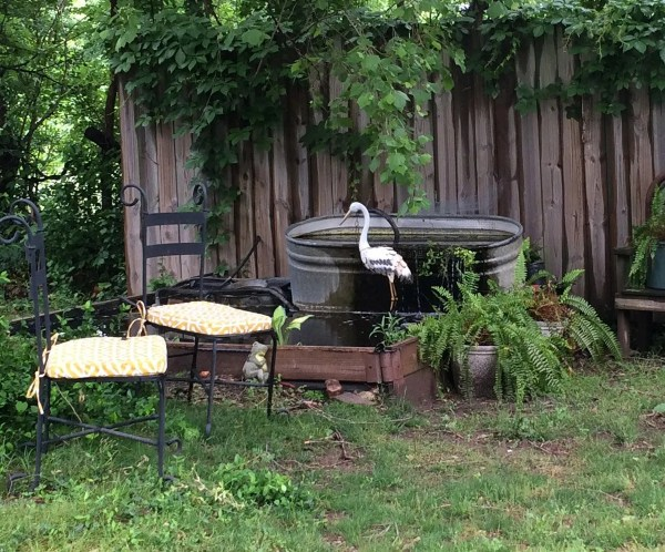 2014 pond set up with seating and metal yard art heron