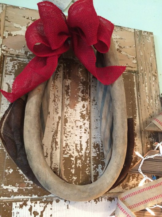 horse collar decorated with burlap bow for christmas