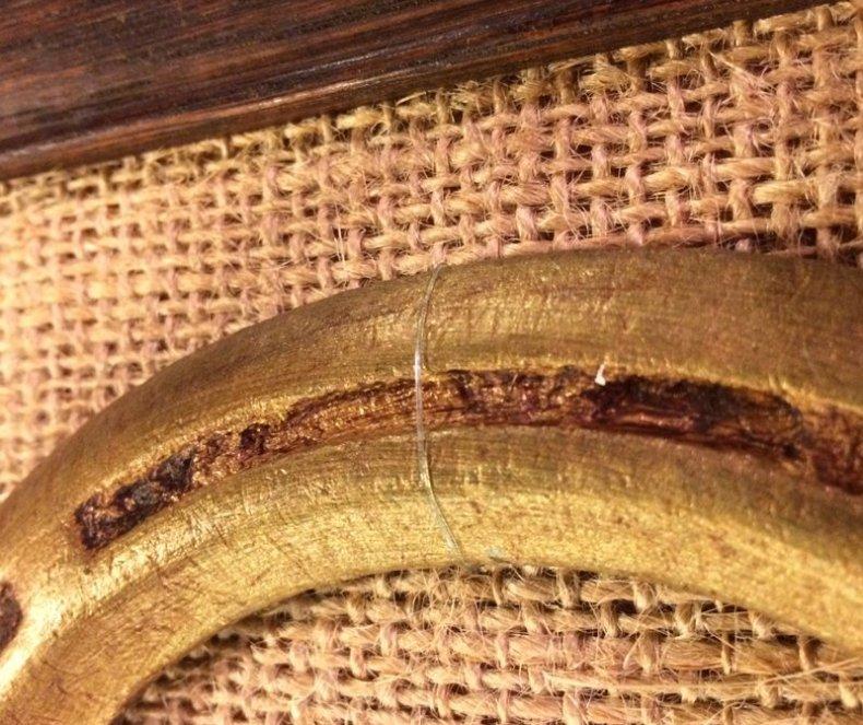 securing horseshoe into frame