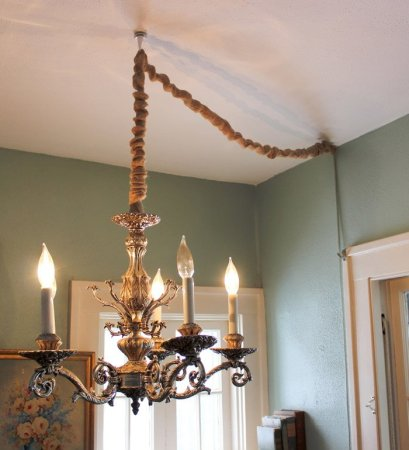 How to Hang a Chandelier in a Room without Wiring for an Overhead     Hang a Chandelier without hardwiring by converting to a lamp and then  covering the cord