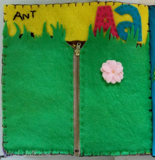 A page of quiet book unzips to reveal an ant farm!