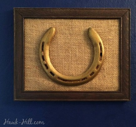 gold horse shoe framed and antiqued