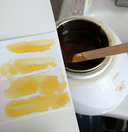 Apply wax to strips while the wax is hot, then cool and cut strips apart.