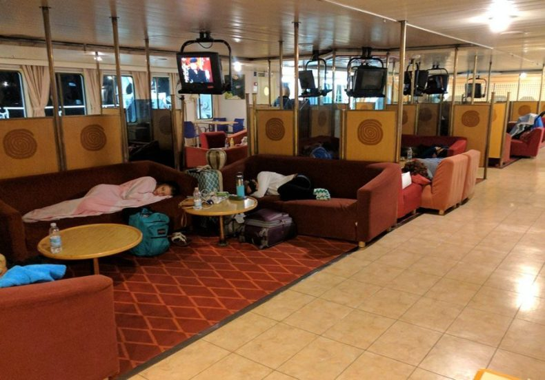 """Economy deck passengers sleeping on couches aboard ferry """"Zadar"""""""