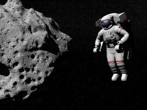 אסטרונאוט מרחף ליד אסטרואיד קטן. אילוסטרציה: shutterstock