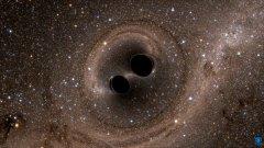 הדמייה של התמזגות שני חורים שחורים, שעל קיומה הצביעו גלי הכבידה שתועדו על ידי LIGO. מקור: The SXS (Simulating eXtreme Spacetimes) Project.