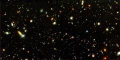 חידת האנרגיה האפלה, המסתורין של מדוע התפשטותו של היקום מאיצה, היא אגוז קשה לפיצוח. צילום: NASA and A. Riess (STScI), CC BY.