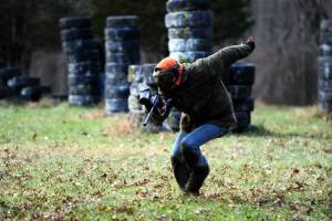 Paintball Camp - Camper running during paintball game.