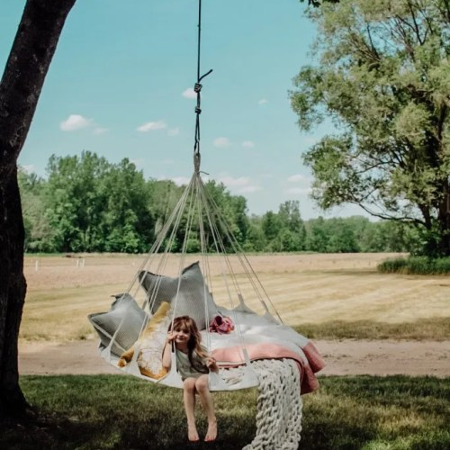 The Coziest Outdoor Nest Swing