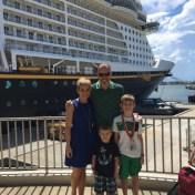 Family-photo-outside-Disney-Cruiseline-Terminal-in-front-of-Disney-Fantasy