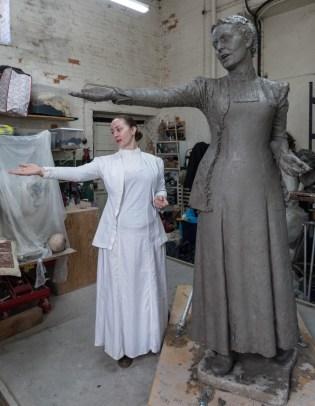 Sarah Jenkins with the Emmeline Pankhurst statue - photo by Nigel Kingston
