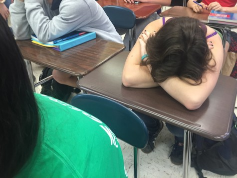 Aly Claycomb, junior, tries to catch up on sleep in class. Sleep deprivation can lead to anxiety or depression.