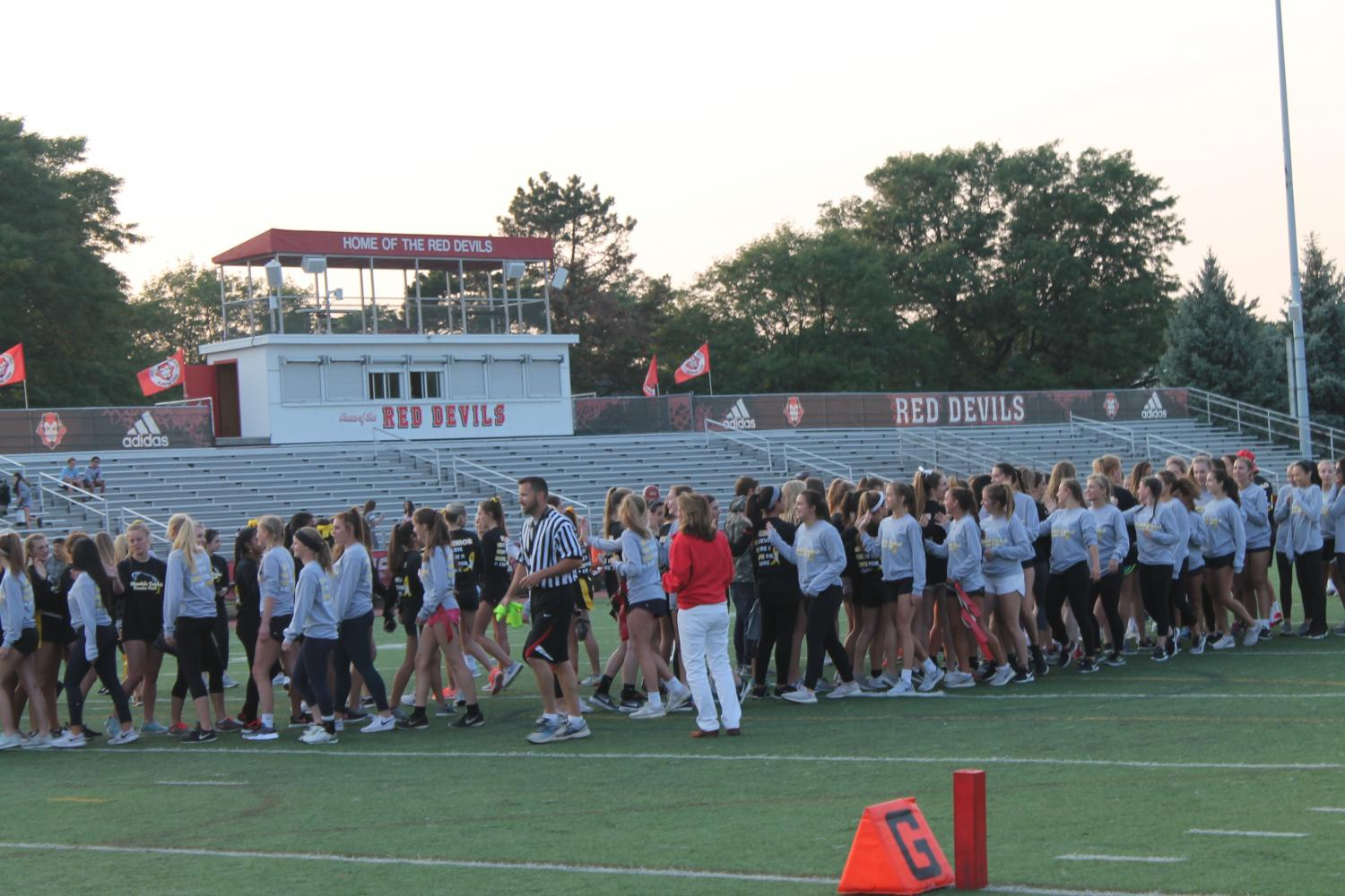 The juniors warmed up before the start of the annual powderpuff game against the seniors. The game marks the beginning of homecoming week.