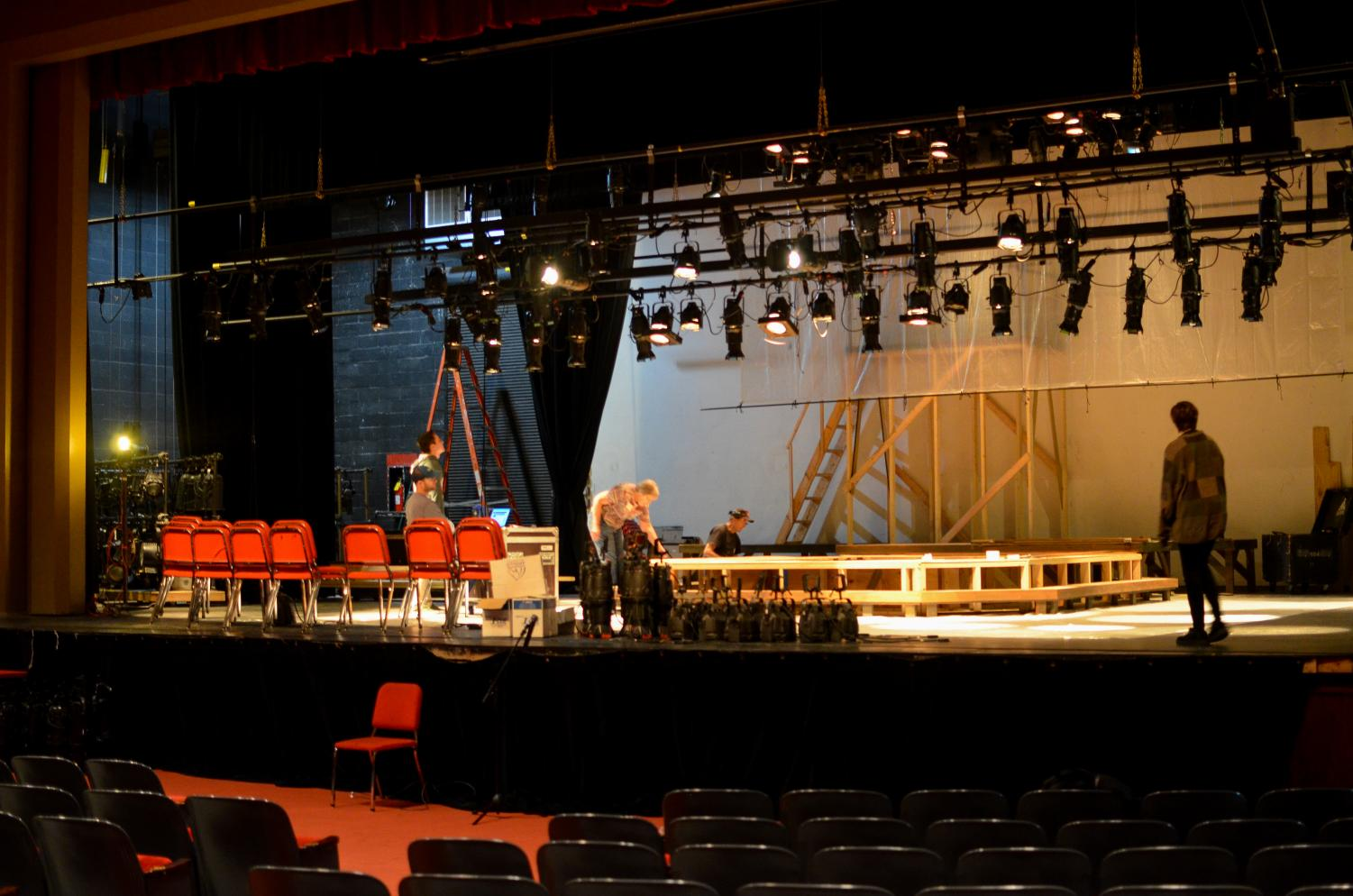 While rehearsals go on almost every day after school, crew members also work for hours to set up the stage and lighting for the play.