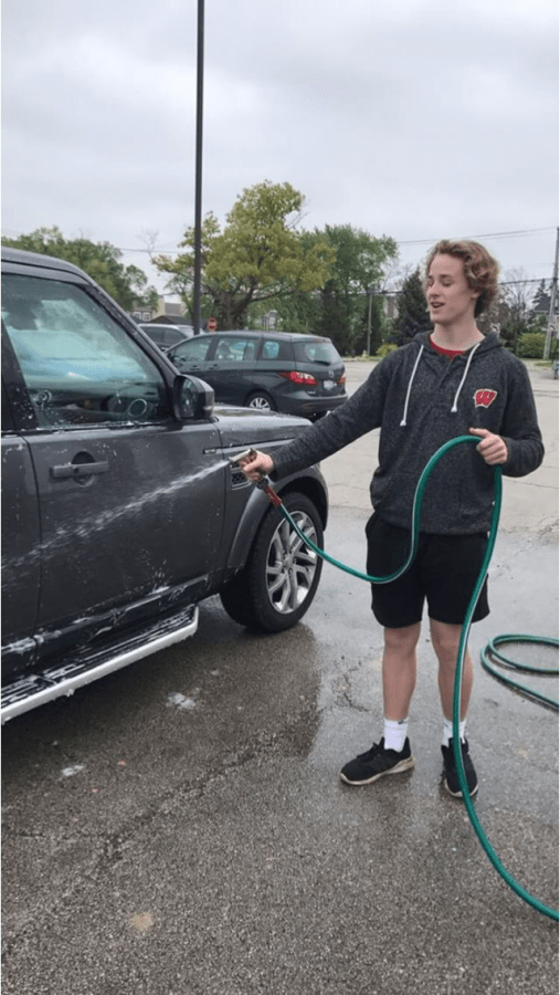 David+Brynan%2C+freshman+class+board+vice+president%2C+was+one+of+the+students+who+took+part+in+the+car+wash+held+in+the+senior+lot+on+Saturday%2C+May+19.+