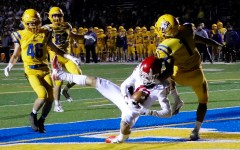 Varsity football dominates Lyons Township