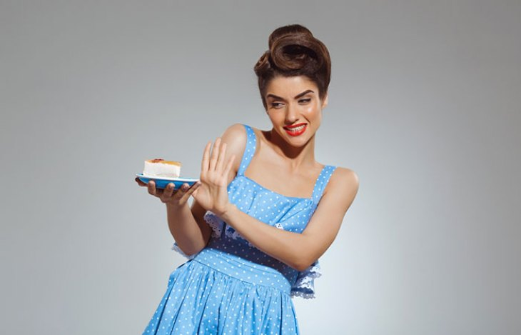 Lady refusing to eat carbohydrates such as pastries