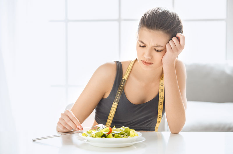 Woman worried with the side-effect of her diet