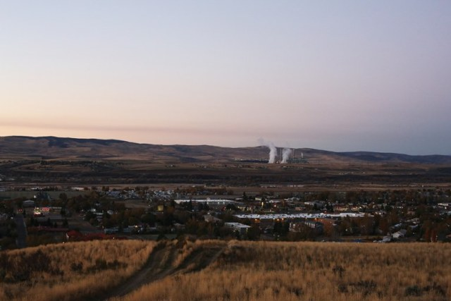 Steam rises from the Craig Station, a coal-fired power plant that sits above the northwest Colorado town of Craig. (Brooke Warren/High Country News)