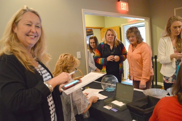 Barbara Armstrong helps participating ladies check in before the fun starts.