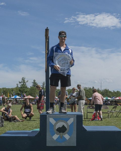 Christian Carswell is named Athlete of the Games for men's track and field Saturday at the 61st annual Grandfather Mountain Highland Games in Linville, N.C. Photo by Skip Sickler | Grandfather Mountain Stewardship Foundation