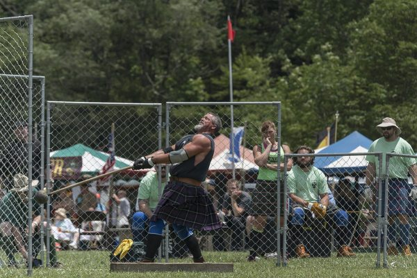 Brady Miller prepares to launch the 22-pound hammer in the professional Scottish heavy athletics portion of the Grandfather Mountain Highland Games. Miller finished second overall. Photo by Skip Sickler | Grandfather Mountain Stewardship Foundation