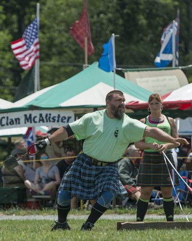 Brent Miller, 61st annual Grandfather Mountain Highland Games professional Scottish athletics champion, sends a 56-pound weight 17 feet in the air. Photo by Skip Sickler | Grandfather Mountain Stewardship Foundation