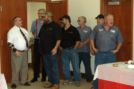 Some of the employees of AppalCART stand in the corner during celebration. Photo by Jesse Wood