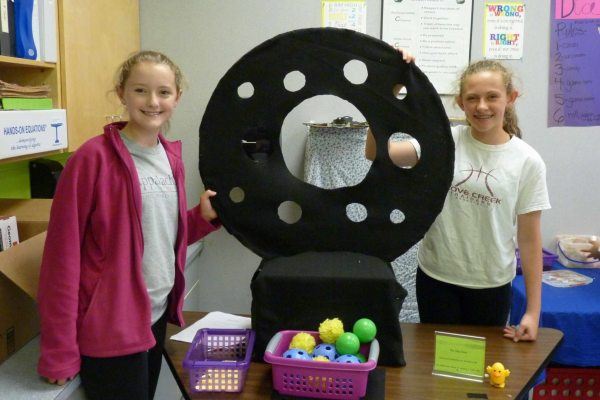 Skyler Combs and Mattie Smith invited students and teachers to test the odds on tossing a ball through their creation.
