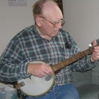 Clifford Glenn playing a banjo built by his father, Leonard. Photo courtesy of Mark Freed.